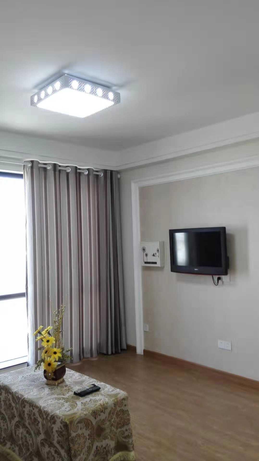 12021出售玉兰花园5/30楼  89平方,2室2厅1厨1卫  精装修,带车位车棚95万的实拍照片