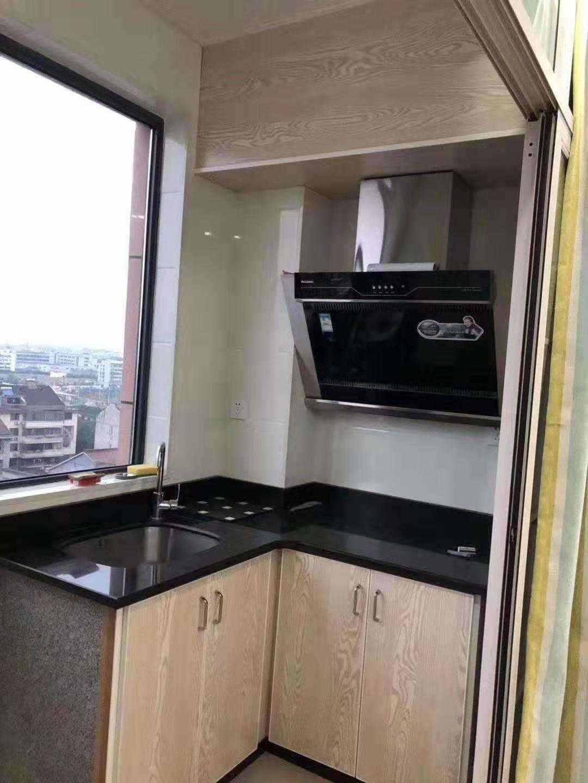 A02051出售三江城富民大厦单身公寓33.4平朝北,精装修,现在正在出租 ,售价26万的实拍照片