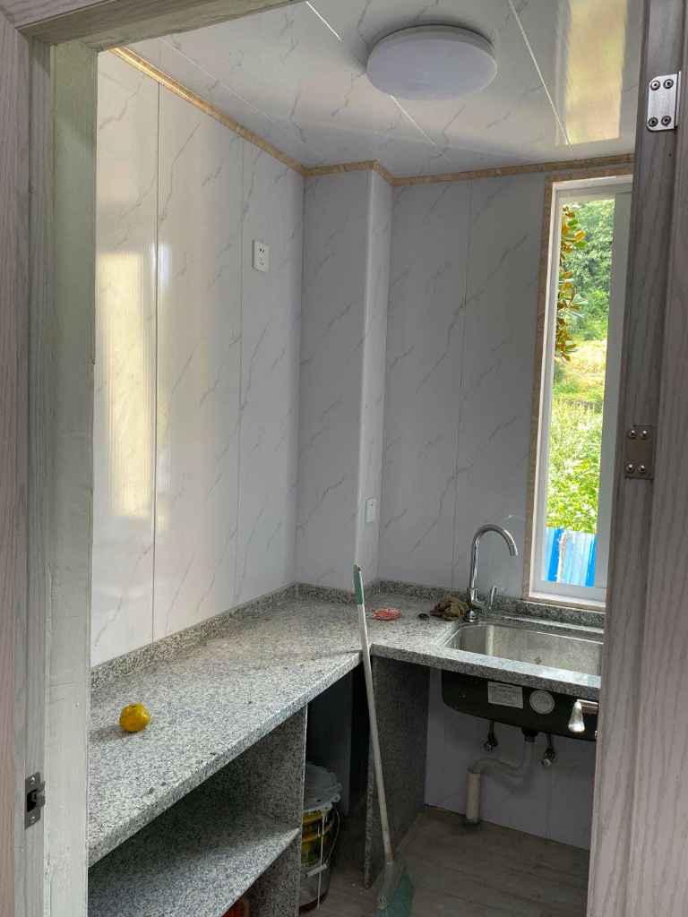 北门新村全新装修有2张床 衣柜 餐桌,电瓶车可以到门口的实拍照片