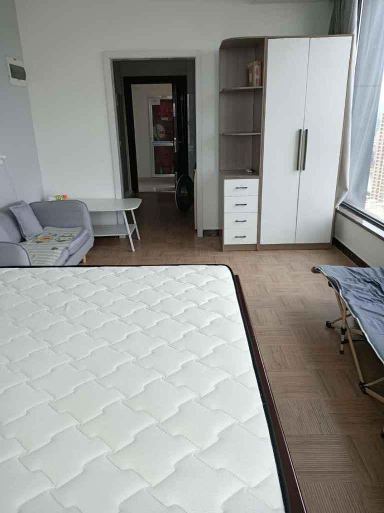 00吾悦广场25楼单身公寓精装修家电家具齐全的实拍照片